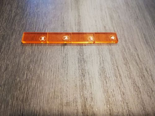 4-inch ruler in orange methacrylate